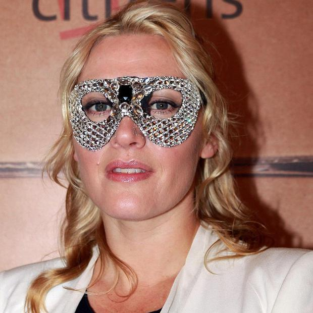Kate Winslet wears a Beaton's Atelier ball mask to host a London fundraising dinner for the charity Cardboard Citizens