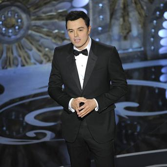 Seth MacFarlane speaks on stage during the 2013 Oscars at the Dolby Theatre in Los Angeles (Chris Pizzello/Invision/AP)