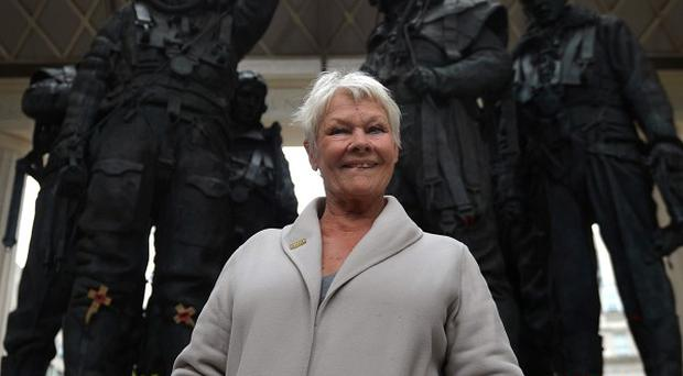 Dame Judi Dench during a visit to the Bomber Command Memorial in Green Park, London