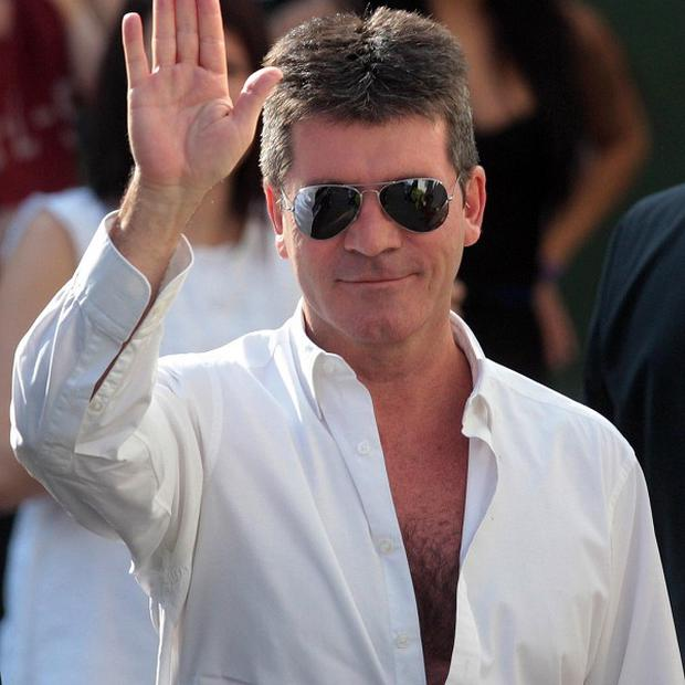 Simon Cowell will have X Factor 'Charlie's Angels' in the form of Demi Lovato, Kelly Rowland and Paulina Rubio