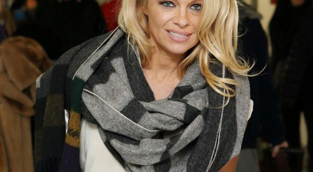 A TV ad starring Pamela Anderson has been banned for degrading women