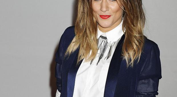 Caroline Flack says getting a boyfriend is not her top priority