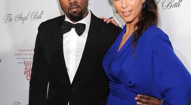 Kanye West's reps have shot down claims he cheated on Kim Kardashian