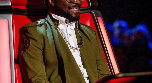 Will.i.am joked he'd like to push a button to catapult rejected contestants off The Voice