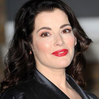 Nigella Lawson's husband Charles Saatchi accepted a police caution for assault