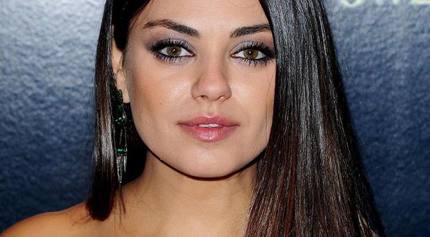 Mila Kunis didn't fall for Russell Brand's patter