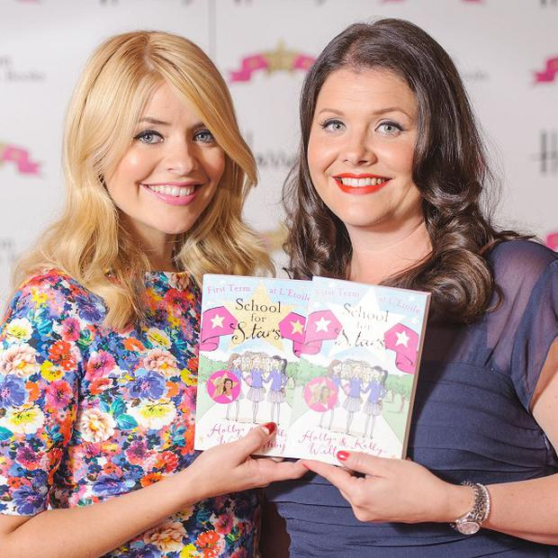 Holly Willoughby and her sister Kelly at a signing session for their book School For Stars