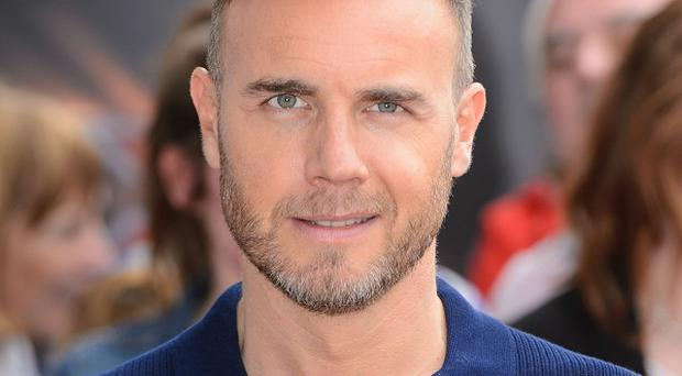 Gary Barlow tried to stir up some passion in a wannabe rocker at The X Factor auditions