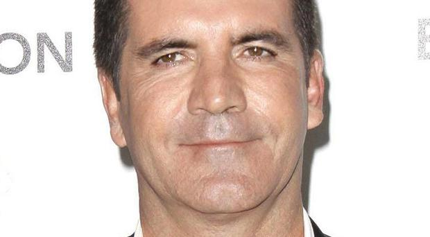 Simon Cowell is reportedly taking BGT to Afghanistan