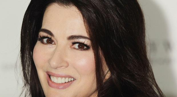 Charles Saatchi says he is to divorce Nigella Lawson