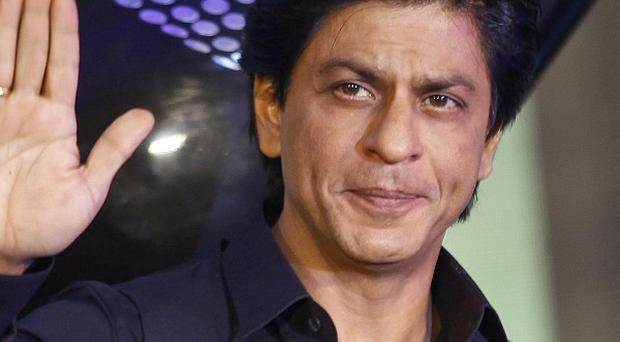 Bollywood actor Shah Rukh Khan denies he knew the gender of his son before the boy's premature birth (AP)