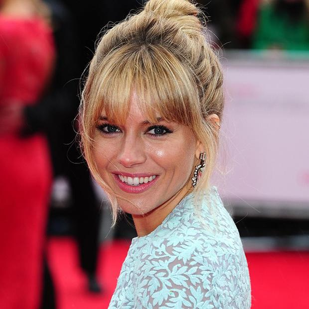 Sienna Miller says motherhood is 'overwhelming'