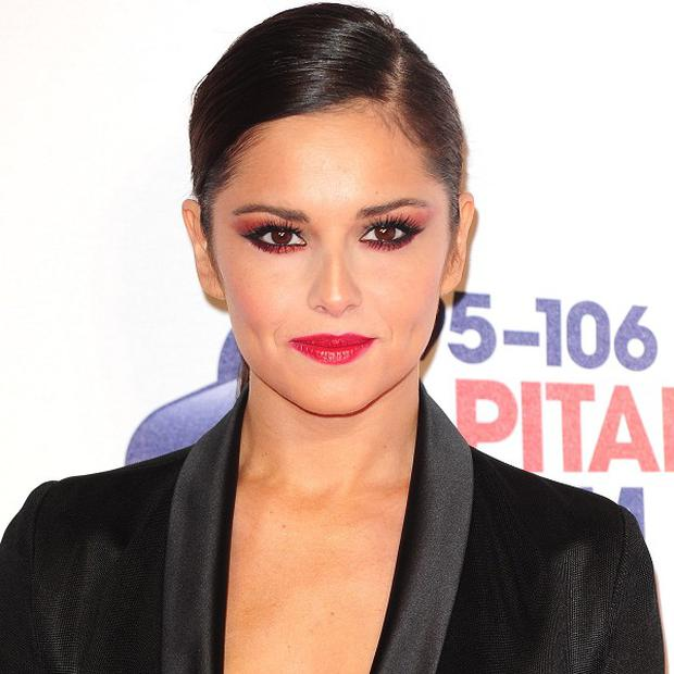 Cheryl Cole has asked fans to pray for her ill dog