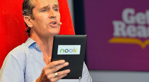 Rupert Everett reads from a book by Oscar Wilde at the Get Reading Festival