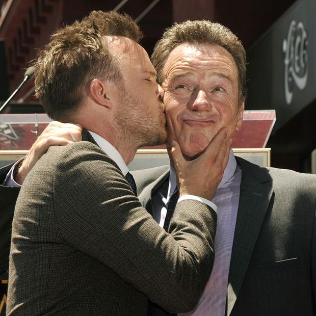 Bryan Cranston gets a kiss from Breaking Bad co-star Aaron Paul