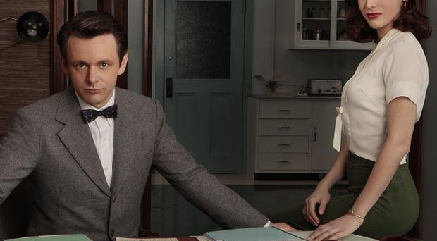 Michael Sheen as Dr William Masters and Lizzy Caplan as Virginia Johnson in Masters of Sex