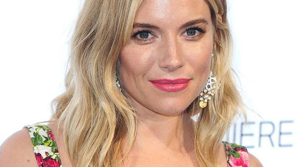 Sienna Miller says only a spectacular acting role will entice her away from being a mum