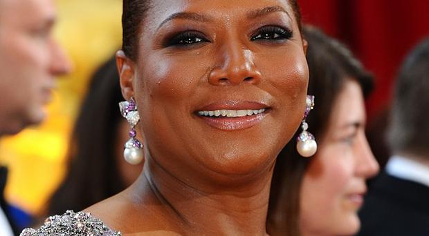 Queen Latifah extended an invitation to President Barack Obama and first lady Michelle Obama to be guests on her new talk show