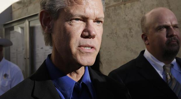 Randy Travis is recovering from a stroke