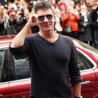 Simon Cowell is reported to be having a baby with Lauren Silverman