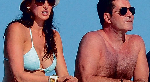 Simon Cowell and Lauren Silverman during holiday