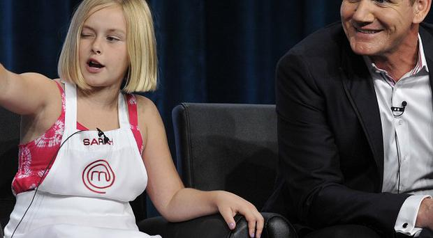 Sarah, left, a contestant on the Fox show Master Chef Junior answers a reporter as judge/executive producer Gordon Ramsay looks on (AP)