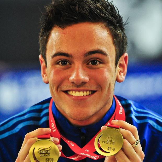 Olympic diver Tom Daley has revealed he is in a relationship with a man