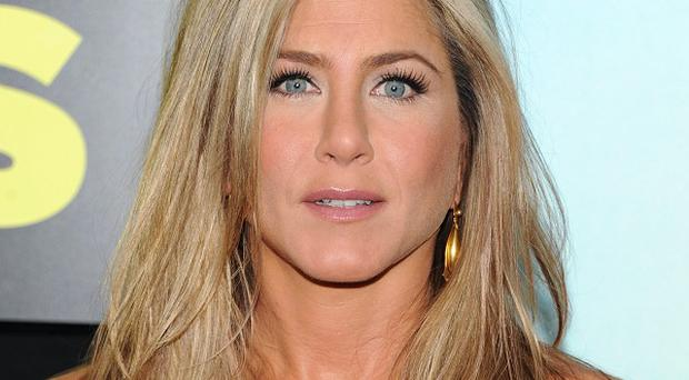 Jennifer Aniston says she doesn't pay attention to speculation about her personal life