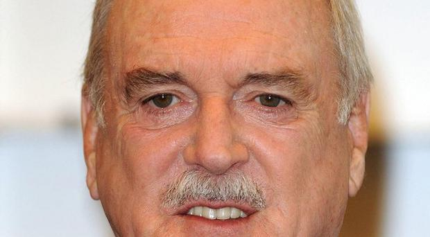 John Cleese had to totally change his writing style for his autobiography