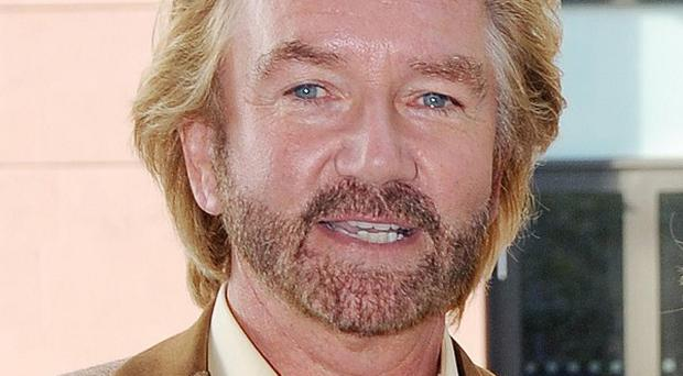 Noel Edmonds is the host of Deal Or No Deal