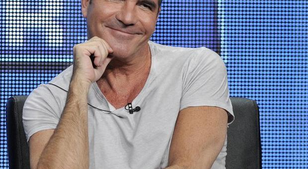Simon Cowell is reported to have fathered a child with Lauren Silverman