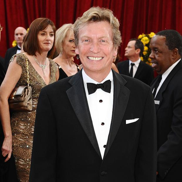 Nigel Lythgoe was surprised by Simon Cowell's baby news
