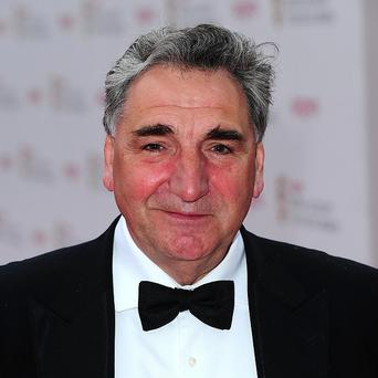 Downton Abbey star Jim Carter is taking to two wheels