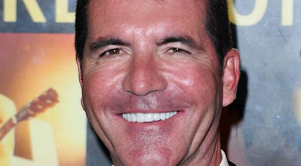 Simon Cowell is set to become a dad for the first time