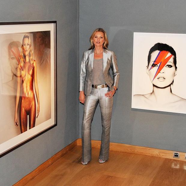Kate Moss posed for pictures with images of herself
