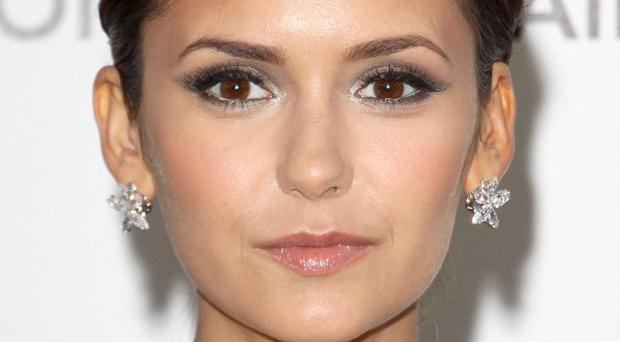 Nina Dobrev loves her dual role in The Vampire Diaries
