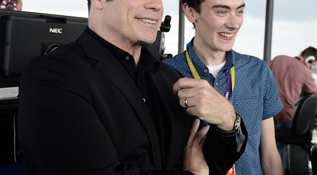 John Travolta takes a look behind the scenes at Heathrow's control tower