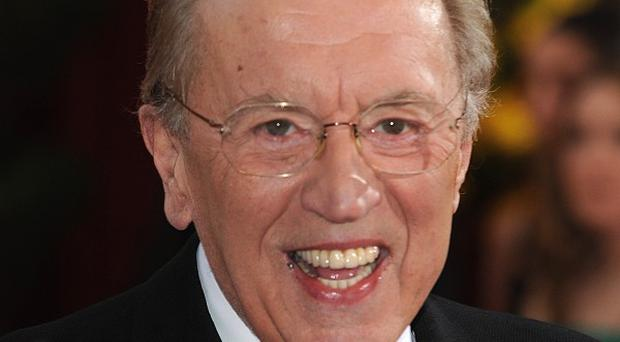 Sir David Frost's friends and family gathered at his funeral to pay tribute to the broadcaster