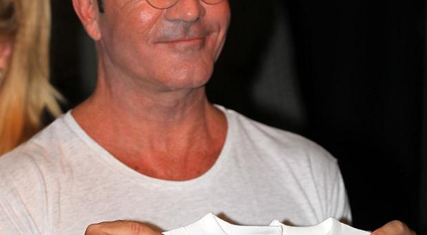 Simon Cowell has no plans to get up for night feeds