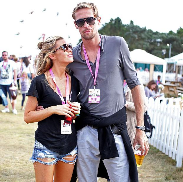 Abbey Clancy has been practising dancing with her tall husband Peter Crouch