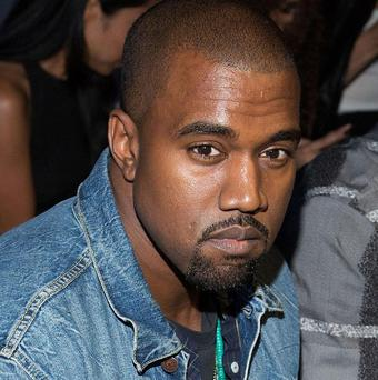 Kanye West had a scuffle with a celebrity photographer at Los Angeles International Airport (Dario Cantatore/Invision/AP, File)