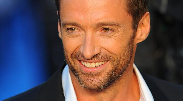 Hugh Jackman is marking the reopening of a small movie theatre in Iowa