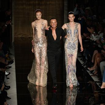 Julien Macdonald with models on the catwalk during his spring summer London Fashion Week show