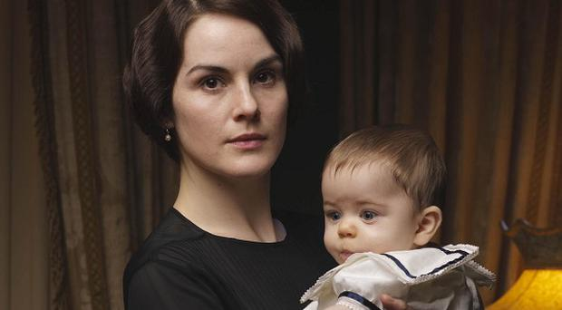 Michelle Dockery thinks Lady Mary will make a good mother