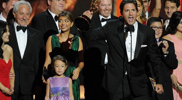 Steven Levitan, foreground, and the cast and crew of Modern Family accept the award for outstanding comedy series at the Primetime Emmy Awards (AP)