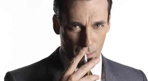 Jon Hamm is to have surgery to remove a polyp on his vocal cord