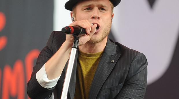 Olly Murs is enjoying his new position on The X Factor