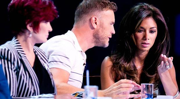 Nicole Scherzinger struggles with some tough decisions on X Factor