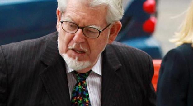 Rolf Harris will face trial in April next year