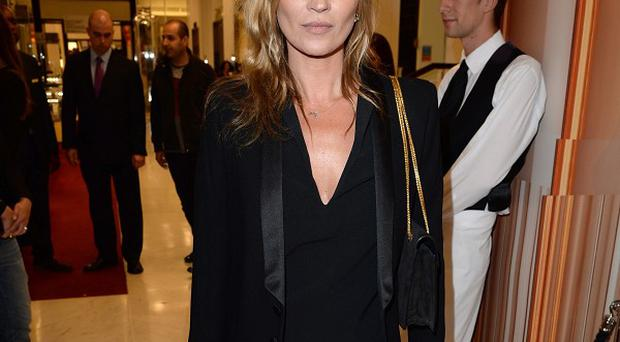 Kate Moss is excited to be working with Topshop again